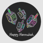 "Dreidel, Dreidel, Dreidel Stickers<br><div class=""desc"">Graphic illustration of a Hannukah dreidels in bright colors.  Brighten up the holiday with this colorful design.</div>"