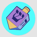 """dreidel for Hanukkah sticker<br><div class=""""desc"""">Nun,  gimel,  hay,  and shin are the Hebrew letters used on the dreidel outside Israel (they represent the phrase,  """"A great miracle happened there."""")</div>"""