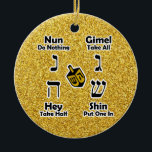 """Dreidel Instructions Happy Hanukkah - Gold Glitter Ceramic Ornament<br><div class=""""desc"""">Decorative and convenient way to keep instructions for playing the Jewish children's game of dreidel at hand... your kids can take a look when they need a reminder of how to play and what the Hebrew letters are called. Great Hanukkah gift! BE SURE TO CHANGE THE MESSAGE ON BACK OF...</div>"""