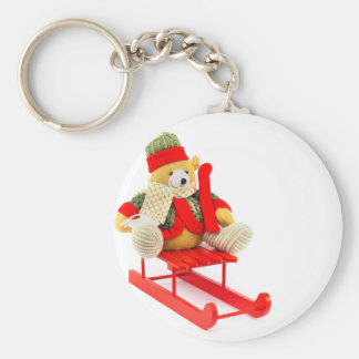 Dressed Christmas bear on red wooden sleigh Keychain