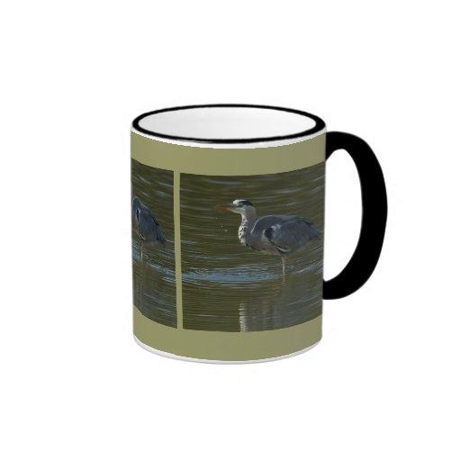 Dribbling Heron Mugs