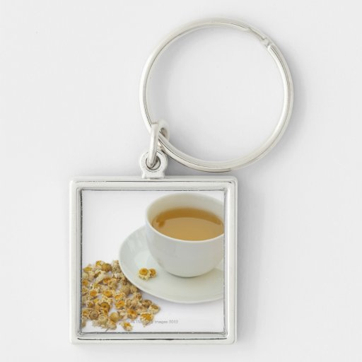 Dried camomile flowers beside a cup of camomile Silver-Colored square keychain