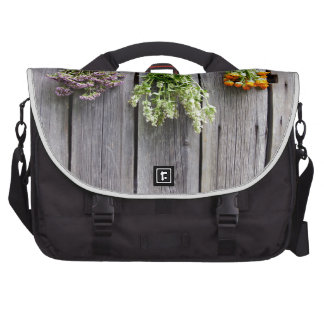 dried herbs wooden vintage grey wall laptop computer bag