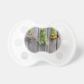 dried herbs wooden vintage grey wall baby pacifiers