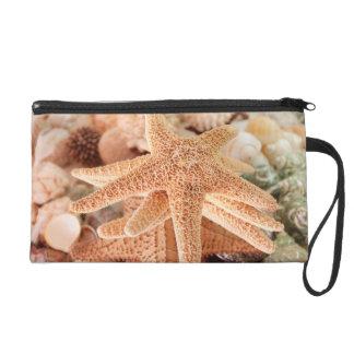 Dried sea stars sold as souvenirs 2 wristlet purse