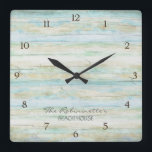 "Driftwood Ocean Beach House Coastal Seashore Square Wall Clock<br><div class=""desc"">COLOR PALETTE: Soft grey, blue and tan DESIGN COLLECTION: This entire collection of Beach House Home D&#233;cor Accessories can be personalized with your name, monogram or message. Use the easy to customize template fields. Hand painted in watercolor, this simple yet trendy driftwood, worn, faded, distressed antiqued wooden background has great...</div>"