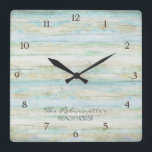 """Driftwood Ocean Beach House Coastal Seashore Square Wall Clock<br><div class=""""desc"""">COLOR PALETTE: Soft grey, blue and tan DESIGN COLLECTION: This entire collection of Beach House Home D&#233;cor Accessories can be personalized with your name, monogram or message. Use the easy to customize template fields. Hand painted in watercolor, this simple yet trendy driftwood, worn, faded, distressed antiqued wooden background has great...</div>"""