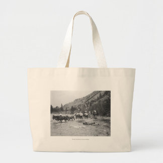 Driving pack mules across a river large tote bag