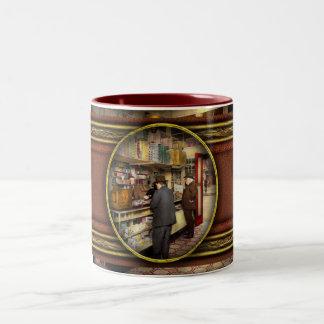 Droguería - exija el cambio por favor 1920 taza de café de dos colores