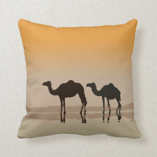 Dromedary camels and a mirage throw pillow