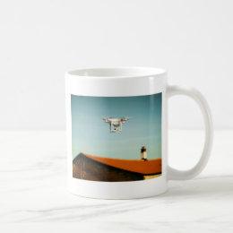 Dron above roofs coffee mug