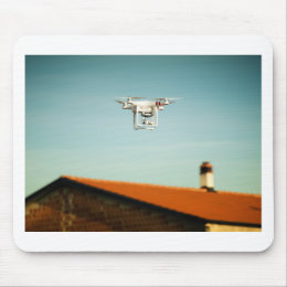 Dron above roofs mouse pad