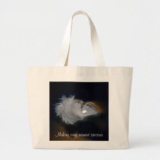 Droplet of water on a white feather large tote bag