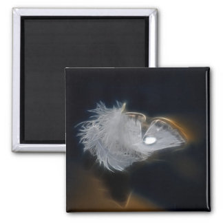 Droplet of water on a white feather magnet
