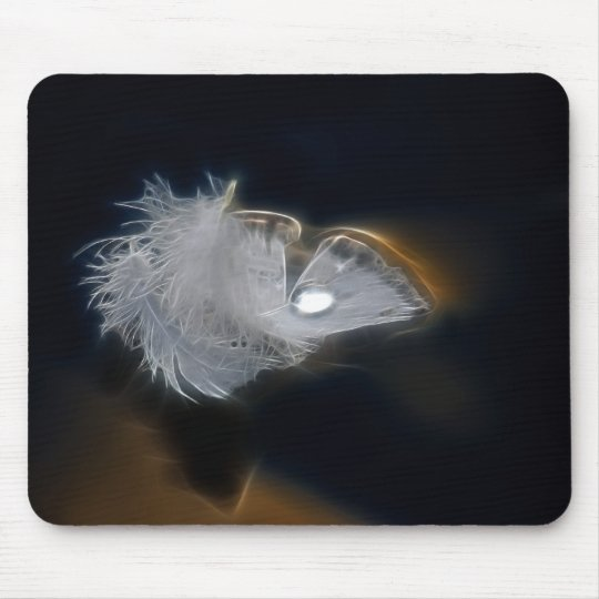 Droplet of water on a white feather mouse pad