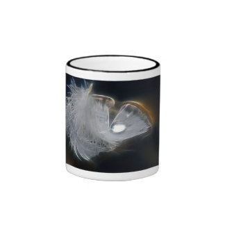 Droplet of water on a white feather ringer coffee mug