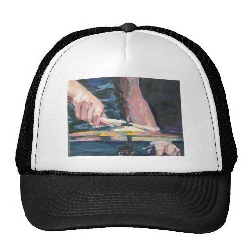 Drummer hands trucker hat