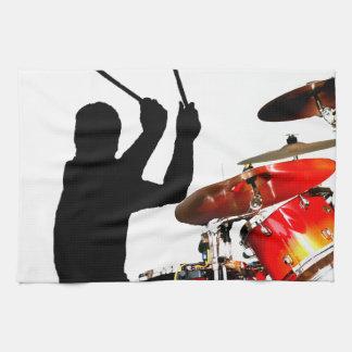 Drummer sticks in air shadow real drums towel