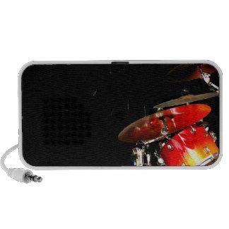 Drummer sticks in air shadow real drums mini speakers