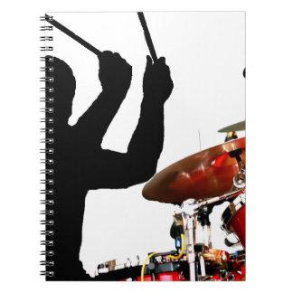 Drummer sticks in air shadow real drums spiral notebook