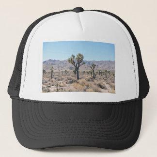Dry brush and trees in the desert trucker hat