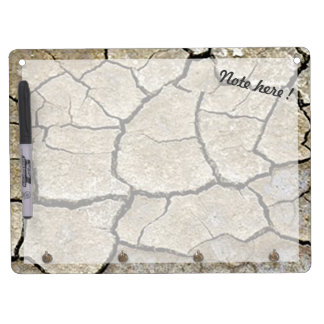 Dry cracked desert ground and sand dry erase board with keychain holder