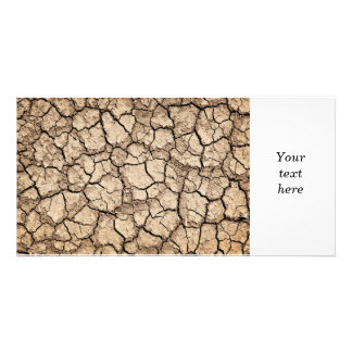 Dry cracked ground during drought photo card