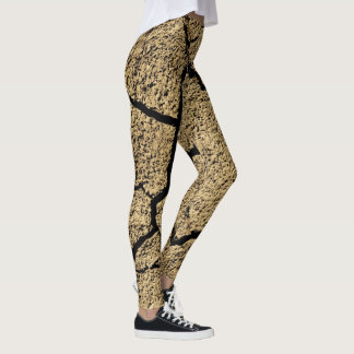 Dry land with cracked earth in drought leggings