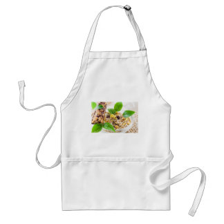 Dry mix of muesli and cereal in a bowl of glass adult apron