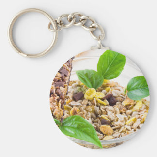 Dry mix of muesli and cereal in a bowl of glass keychain