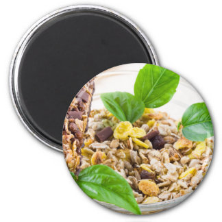 Dry mix of muesli and cereal in a bowl of glass magnet