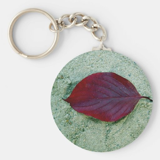 Dry Red autumn leaf laying on sand Basic Round Button Keychain