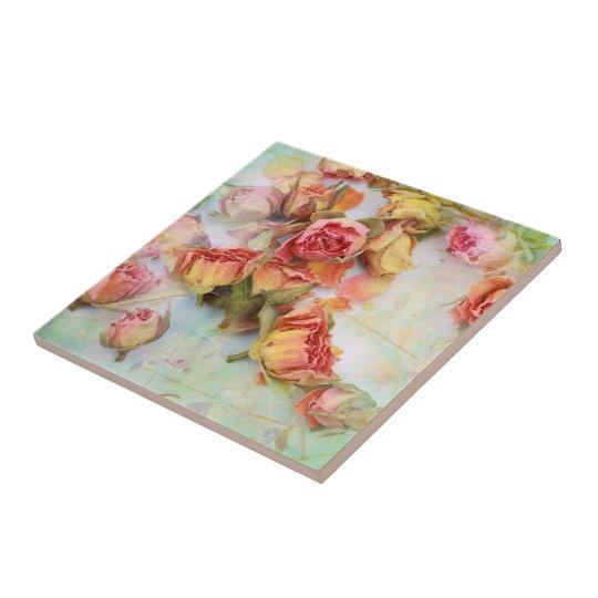 Dry roses on green vintage tile