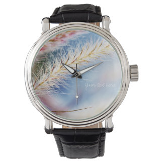 Dry spikelets on blue wrist watches