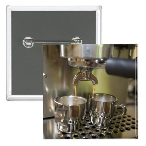 Dual espresso shots being brewed. 2 inch square button