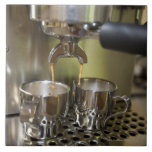 Dual espresso shots being brewed. large square tile