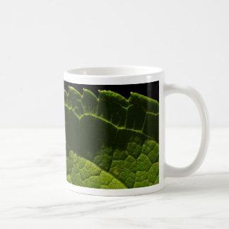Dual lit leaf in the dark coffee mug