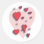 Ducha de corazones rojos pegatina redonda