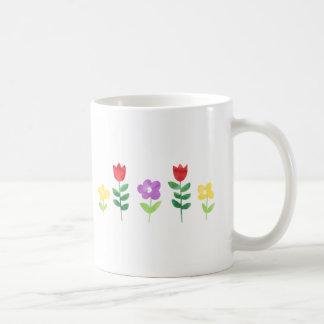 Duchas y taza de las flores
