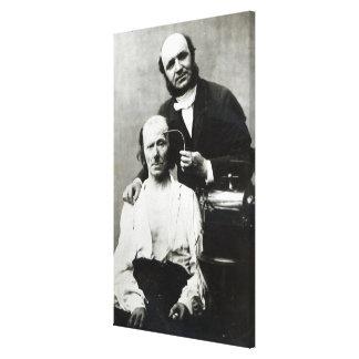Duchenne de Boulogne with a 'victim patient' Canvas Print