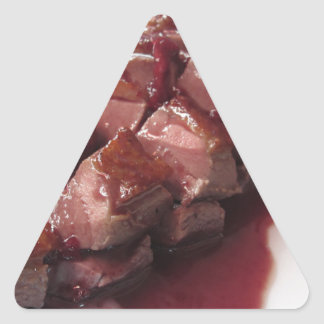 Duck breast on Sangiovese red wine sauce Triangle Sticker