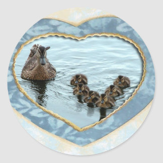 Duck formation in heart classic round sticker
