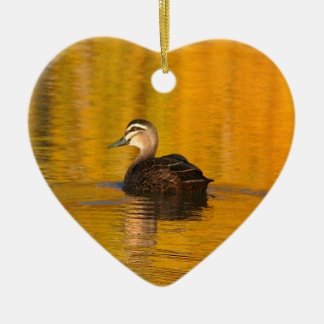 Duck on a golden pond ceramic ornament