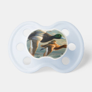 Ducks flying over the sea With a small boat below Pacifier