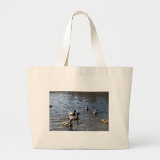 ducks in water, green timber park large tote bag