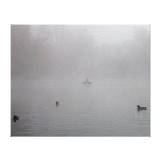 Ducks on a foggy lake canvas print