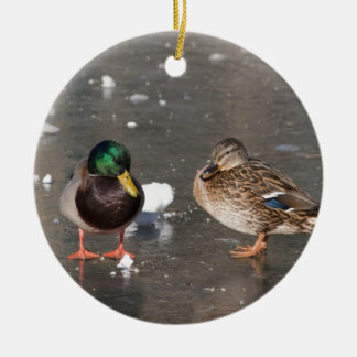 """ducks on black ice"" ceramic ornament"