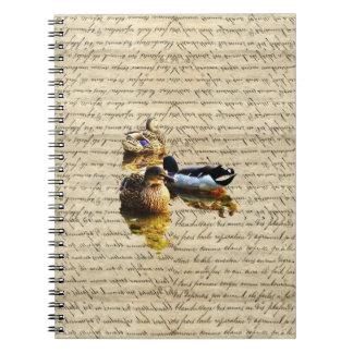 Ducks on vintage paper notebook