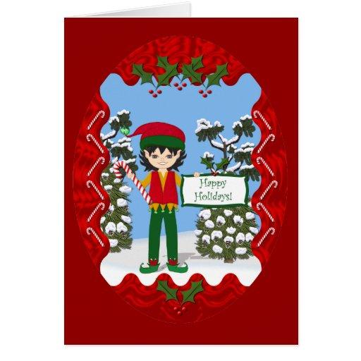 Duende del navidad con la tarjeta de los bastones