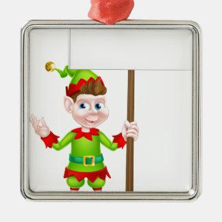 Duende del navidad que lleva a cabo la muestra adorno navideño cuadrado de metal